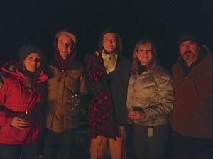 family at bonfire
