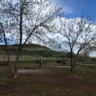 Non-electric tent sites back up to open space.